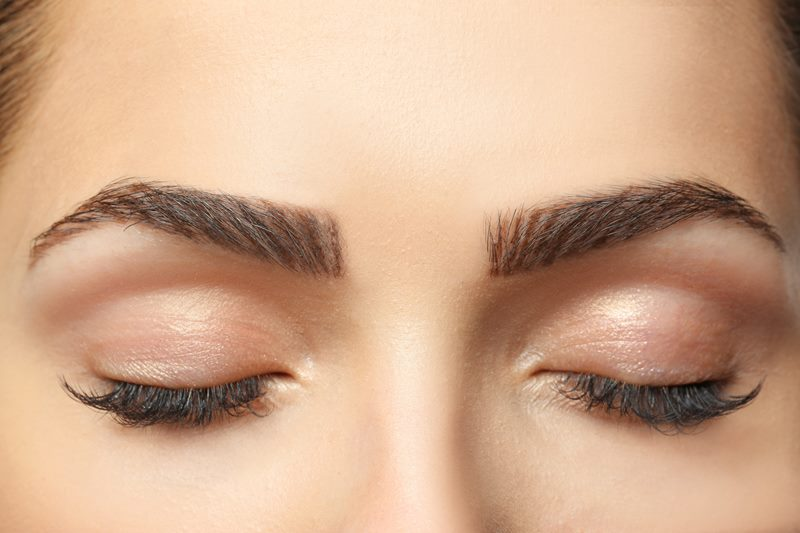 Young woman with beautiful eyebrow lamination